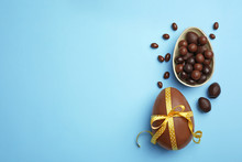 Tasty Chocolate Easter Eggs On Color Background, Top View With Space For Text