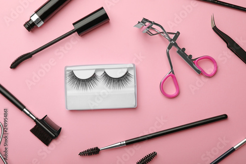 Flat lay composition of professional makeup tools and false eyelashes on color b Wallpaper Mural