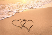 Romantic Honeymoon Holiday Or Valentine's Day On The Beach Concept With Two Hearts Drawn On The Sand, Tropical Getaway For Couples, Love Symbol