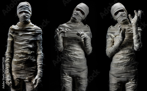 Photo Set of studio shot portrait of young man in costume dressed as cosplay of scary mummy pose in several manners on black background