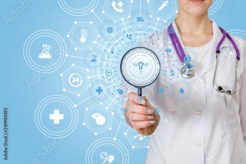 Obraz na plátně  A doctor with a magnifier and a gynecology structure system.