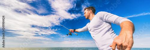 Fototapeta Fishing man casting line fisherman outdoor on blue sky banner background