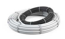 White And Black Pipes For Water. Big Packaging Rolled Up In The Form Of A Ring Tied With A Nylon Ribbon.