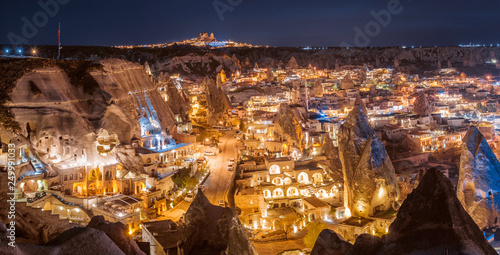 Foto op Plexiglas Oude gebouw Beautiful panoramic view Goreme, Cappadocia, Turkey at night. Famous center of balloon fligths.