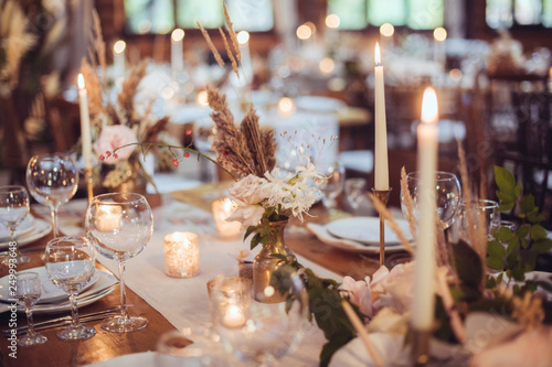 Valokuva  rustic wedding decorations with flowers and candles