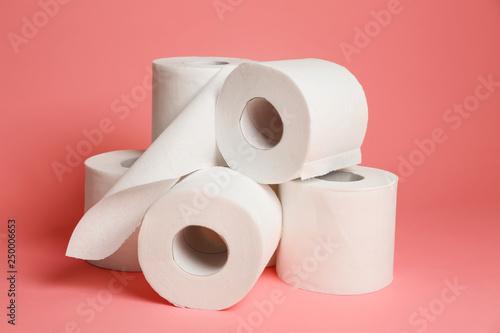Fotografía  Rolls of toilet paper on color background