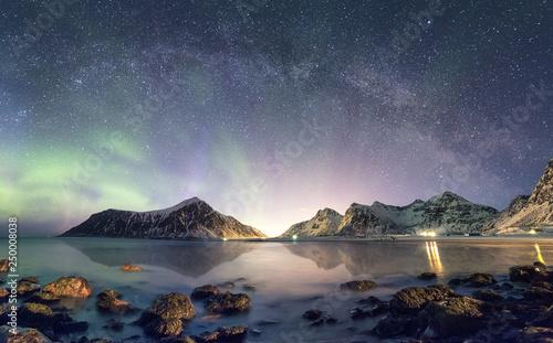 Montage in der Fensternische Nordlicht Panorama of Aurora borealis with Milky way galaxy over snow mountain in coastline