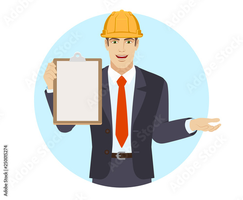 Fotografie, Obraz  Businessman in construction helmet holding the clipboard and gesturing