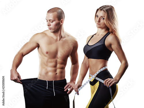 Fotografie, Obraz  Athletic couple isolated over white background