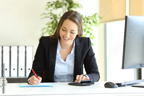 Office worker calculating using calculator