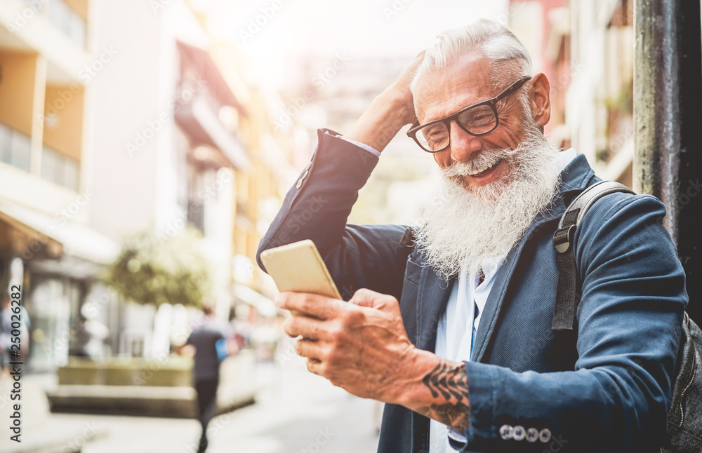 Fototapety, obrazy: Trendy senior man using smartphone app in downtowgn center outdoor