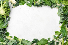 Green Leaf Salad Frame On Grey Concrete Background. Spinach, Kale, Broccoli And Lettuce Greens As Frame With Copy Space For Text, Recipe, Menu Or Products. Clean Eating, Vegetarian Vegan Diet Concept