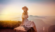 canvas print picture - carefree female relaxing on top of the mountains