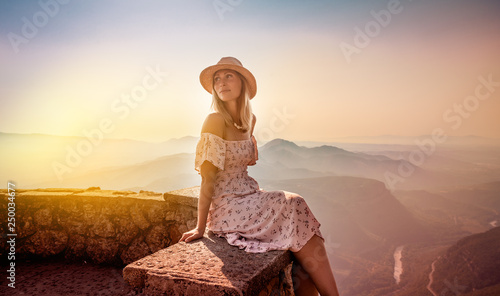 carefree female relaxing on top of the mountains Canvas Print