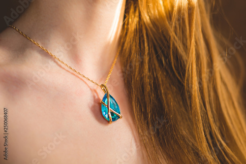 Magnificent necklace on a neck of the young girl Fototapeta