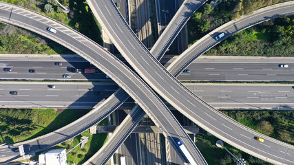 Aerial drone photo of highway multilevel junction interchange crossing road