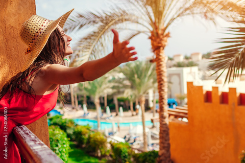 Fototapeta Young woman enjoying the view from hotel balcony in Egypt