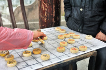 Man's Hand Plays Xiangqi, Know...