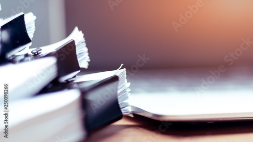 Fototapety, obrazy: Stack of documents placed on a business desk in a business office.