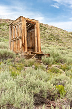 Outhouse On A Hillside