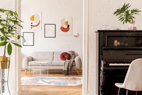 Stylish retro living room with design grey sofa, coffee ...