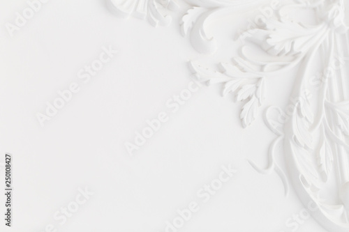 Valokuva  Beautiful ornate white decorative plaster moldings in studio