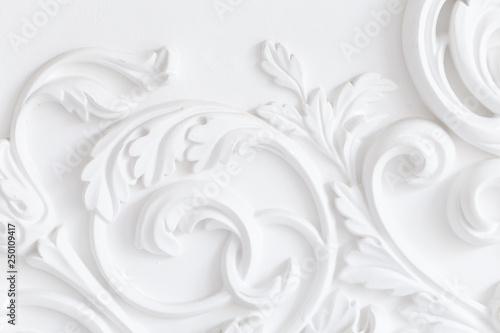 Obraz Beautiful ornate white decorative plaster moldings in studio - fototapety do salonu