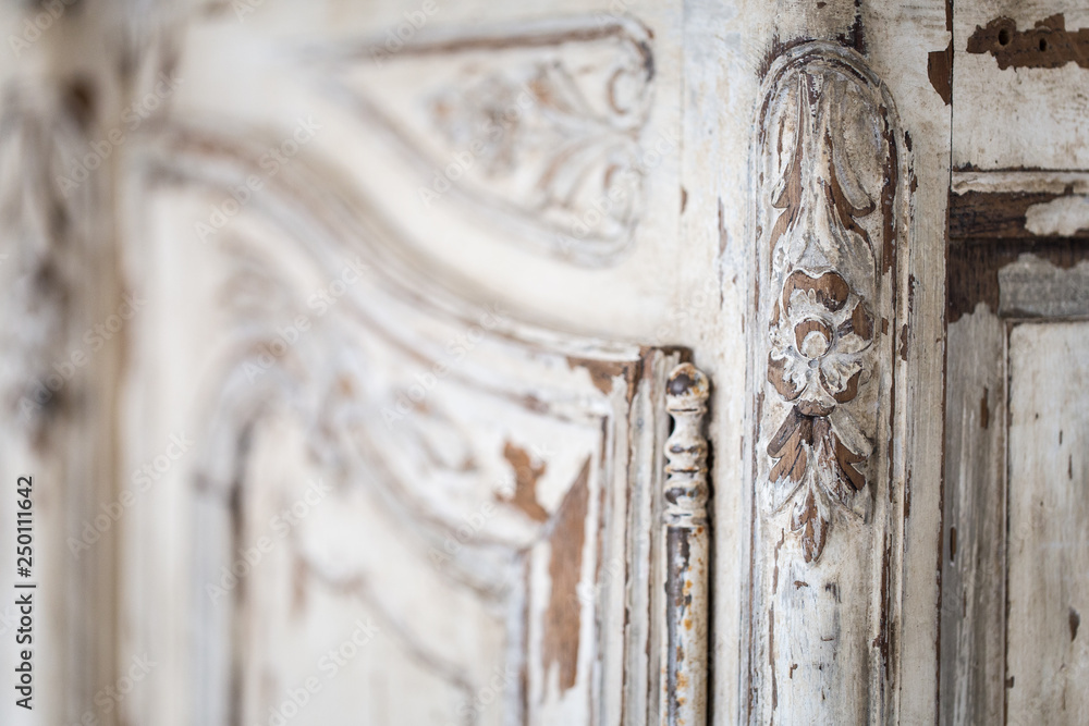 Fototapety, obrazy: Vintage chest of drawers with carving white color with fading and metal handle. Close-up. Selective focus