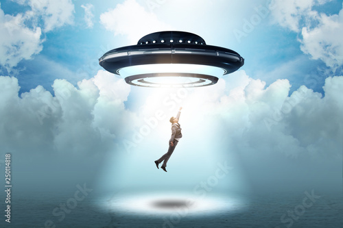 Tuinposter UFO Flying saucer abducting young businessman