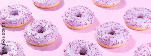 Fotografia, Obraz Pimk donuts on pink background, pattern, hard light