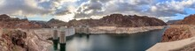 Panorama View Of Hoover Dam. It Is A Concrete Arch-gravity Dam In The Black Canyon Of The Colorado River, On The Border Between The U.S. States Of Nevada And Arizona. It Is Hydroelectric Power Station