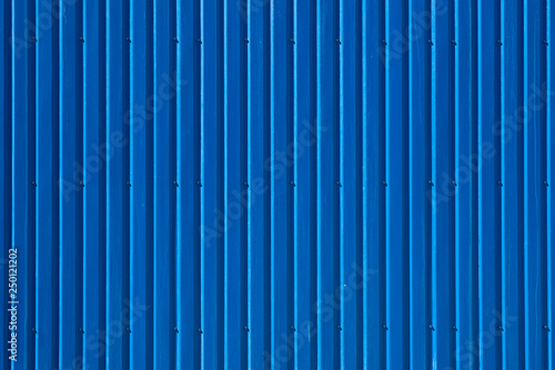 Foto  Blue corrugated steel deck wall. For design, banner and layout