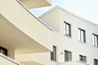 canvas print picture - Modern white building with balcony on a blue sky