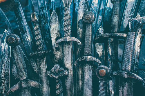 Photo Metal knight swords background. Close up. The concept Knights.
