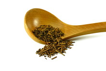 Green Japanese Kukicha (twig Or Stalk Or Stick) Tea Popular At Macrobiotic Diet. Kukicha On A Wooden Spoon.