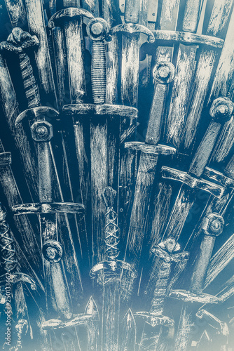 Fotografie, Tablou  Metal knight swords background. Close up. The concept Knights.