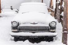 Classic Car Covered With Snow. Retro Car.