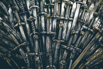 FototapetaMetal knight swords background. Close up. The concept Knights.