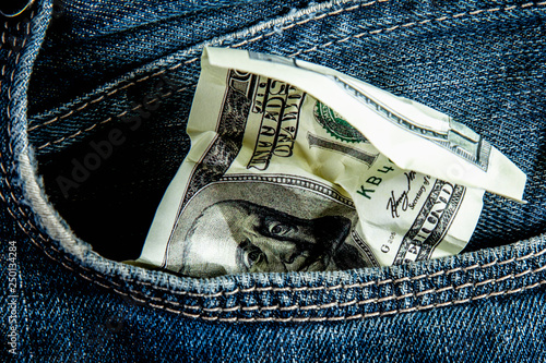 Fotografía  Last crumbled one hundred US Dollar in jeans pocket as symbol of poverty and bankruptcy