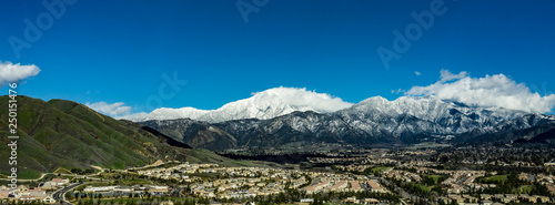 Panoramic, drone view of snow covered Mount San Gorgonio and the Little San Bern Wallpaper Mural