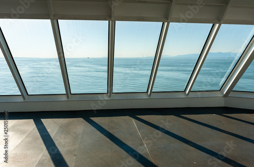 View of ocean through the windows of a ferry deck