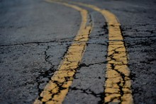 Two Lined Markings On The  Cracked Road