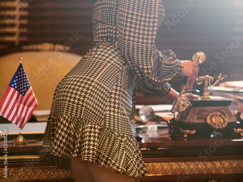 Fotografía  Sexy secretary answer the phone call in boss office
