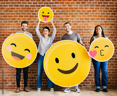 Diverse people holding positive emoticons Poster Mural XXL