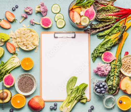 Healthy smoothie ingredients around  clipboard with blank paper sheet on light table, top view, frame Fototapeta