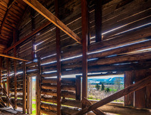 Old Wooden Dilapidated Residential House With Sunlight Penetrating Through Walls
