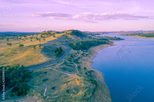 Printed kitchen splashbacks Purple Scenic river and countryside road at sunset - aerial view