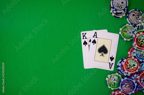 Foto  cards in the poker hand with chips place for text