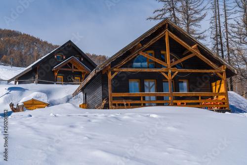 Fotografija Snowy mountain lodge, wooden chalet in winter