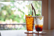 glass of lemon tea and orange soda
